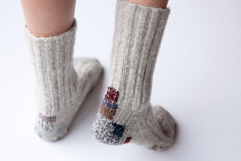 visible mending handmade socks