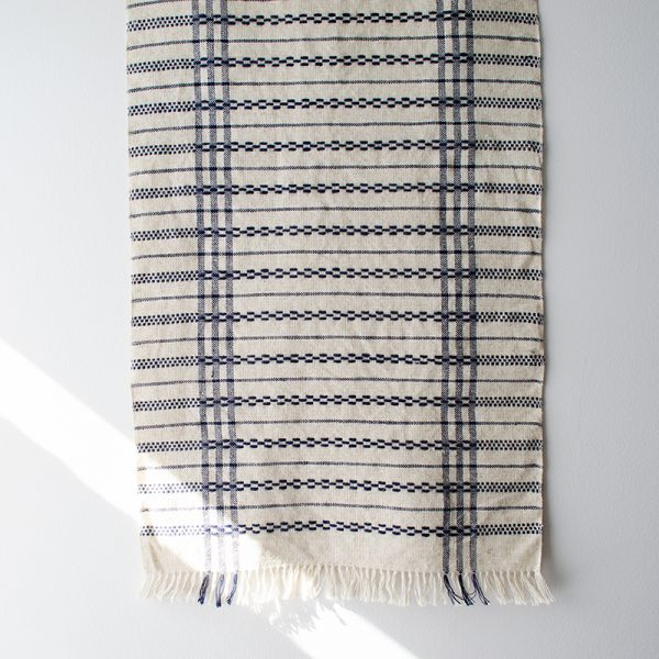 Light coloured handwoven table runner