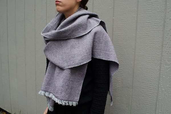 Handwoven scarf wrapped around woman